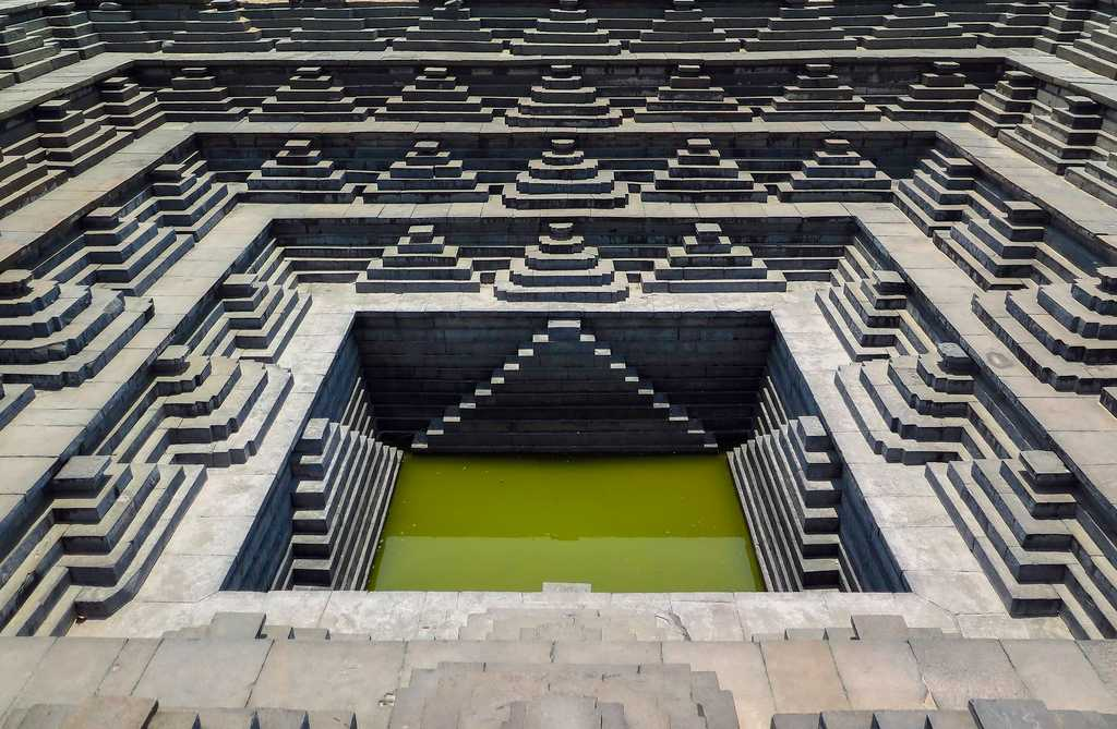 Sacred water stepwell of Ancient India are also known as Pushkarinis in Hampi.